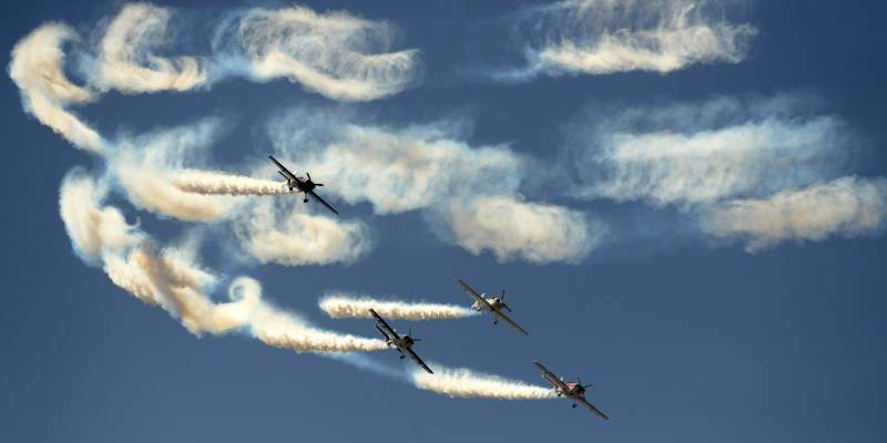 Aircraft from the British Aerobatics Champions team fly during a rehearsal in Ahmedabad on March 31, 2015. The Air Show and Gujarat Aero Conclave 2015 is scheduled to take place in Ahmedabad from April 1 to 4.   AFP PHOTO / Sam PANTHAKY